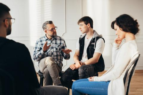 diverse group in therapy or 12 Step group meeting - emotional sobriety